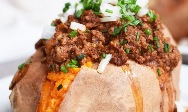 sweet potato stuffed with ground beef and topped with chopped onion and chives