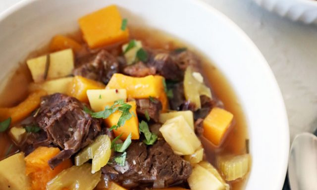beef stew served in a white bowl