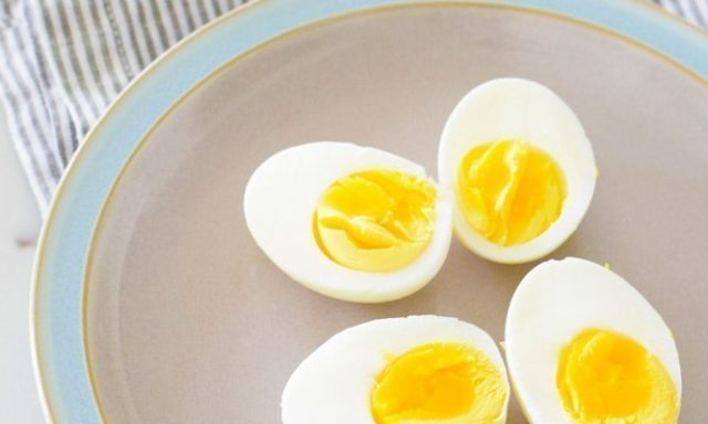 peeled hard boiled eggs on a plate