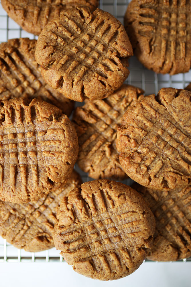 Peanut Butter Collagen Cookies on a wire cooling rack