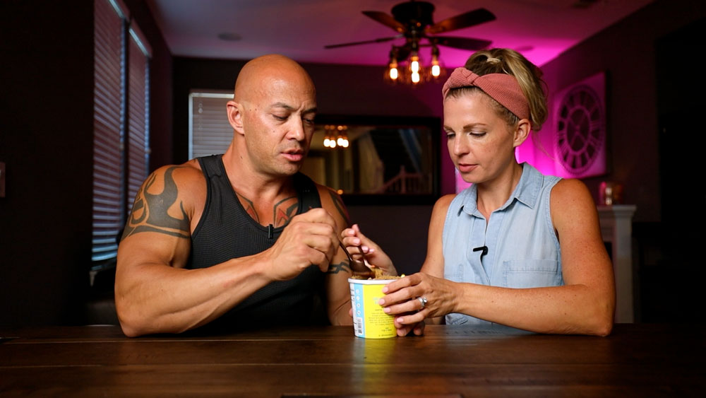 woman and man eating out of a pint of ice cream
