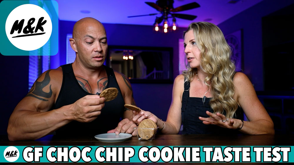 man and woman holding chocolate chip cookies