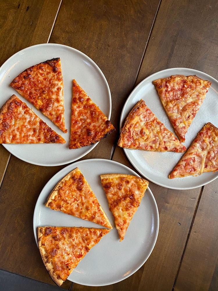 cauliflower pizza slices on 3 different plates