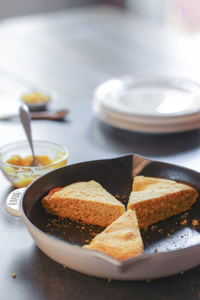 slices of cornbread in a skillet